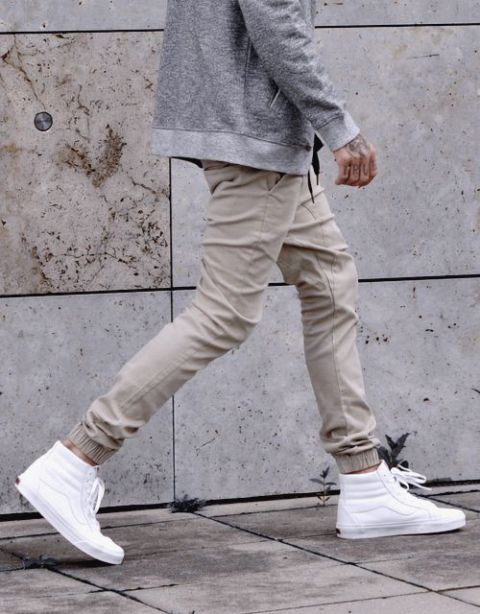 With gray jacket and white sneakers