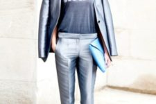 With gray shirt, metallic blazer and black shoes