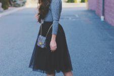 With gray shirt, tulle skirt and mini bag