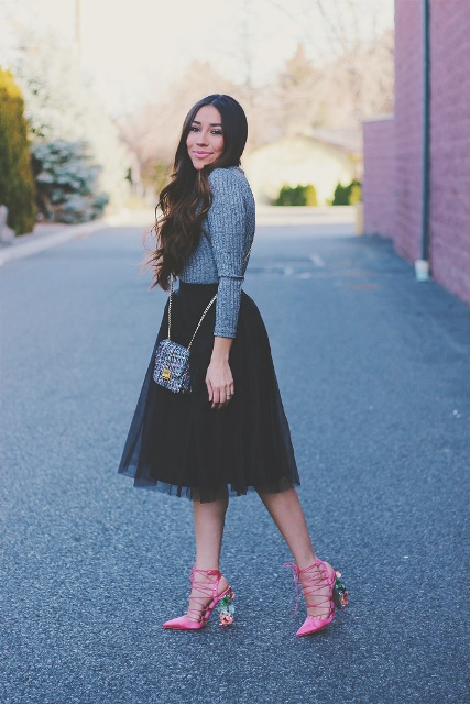 With gray shirt, tulle skirt and mini bag