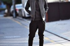 With gray sporty jacket and sneakers