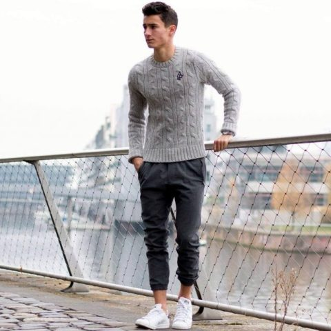 With gray sweater and white sneakers