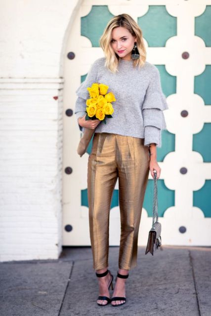 With gray sweater, black sandals and chain strap bag