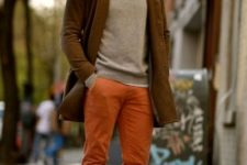 With gray sweatshirt, brown coat and brown boots