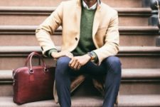 With green sweater, pants, camel coat and big bag