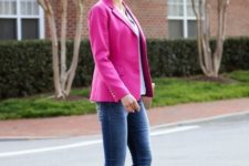 With hot pink blazer and cuffed jeans