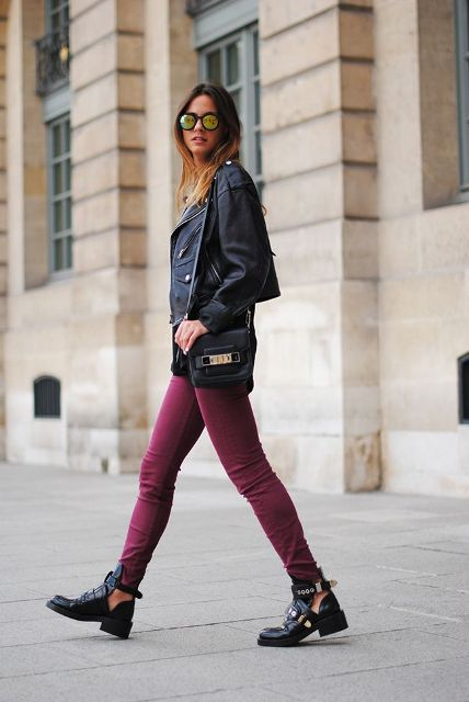 With leather jacket, small bag and purple pants