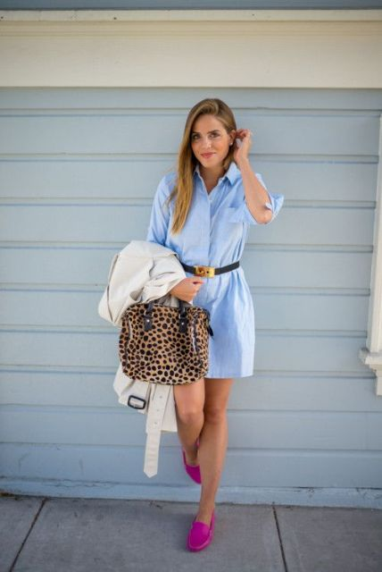 With light blue dress, belt and leopard bag