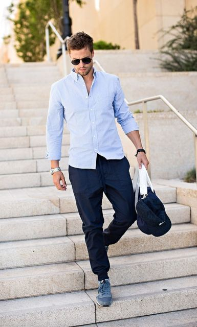 With light blue shirt, blue sneakers and sporty bag