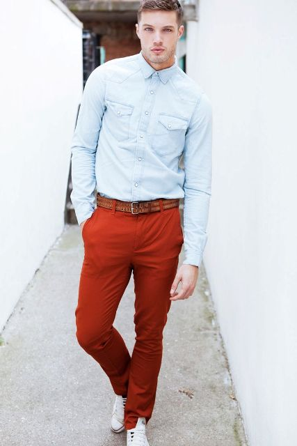 With light blue shirt, brown belt and white sneakers