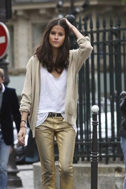 With loose white shirt, beige blazer and black belt