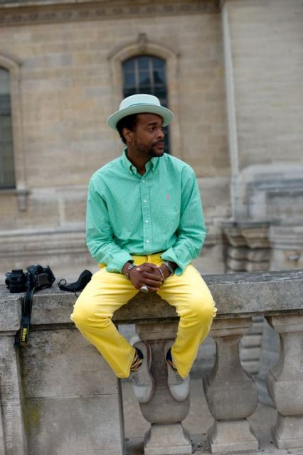 With mint green shirt, hat and gray shoes