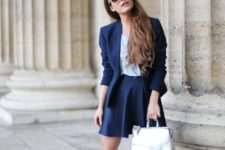 With navy blue blazer and skirt, silver sandals and socks