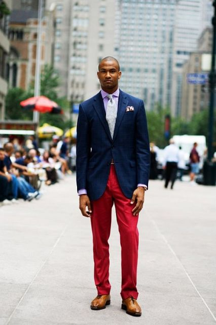 With navy blue blazer, brown shoes and pastel color shirt and tie