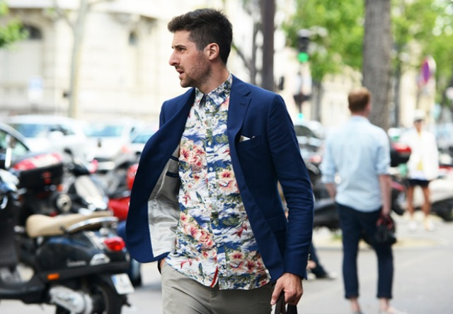 With navy blue jacket and gray pants