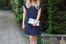 With navy blue mini dress and metallic sandals