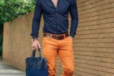 With navy blue shirt, boots and leather bag