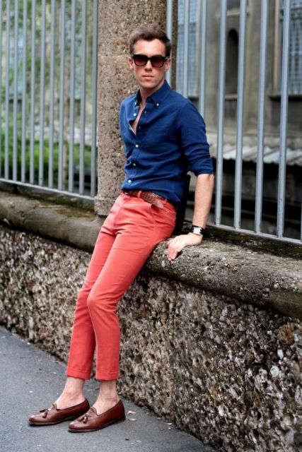 With navy blue shirt, brown belt and loafers