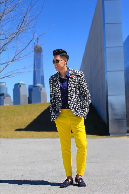 With navy blue shirt, printed jacket and two color shoes