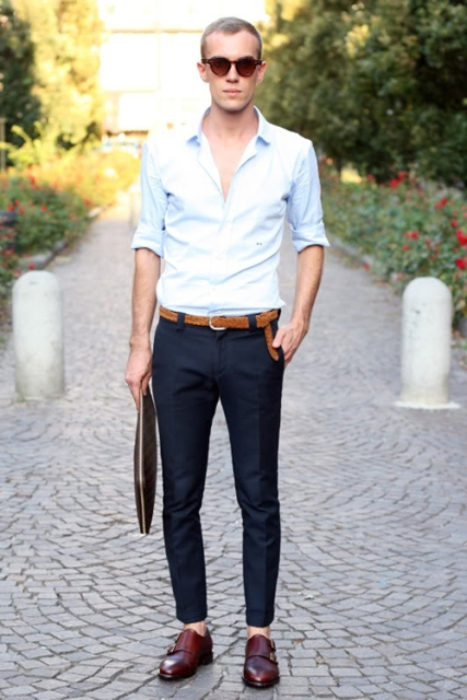 With navy blue trousers, white shirt and leather belt