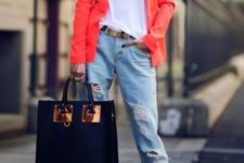 With orange blazer, loose t-shirt, distressed jeans and big bag