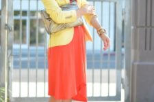 With orange knee-length dress, two color shoes and metallic bag