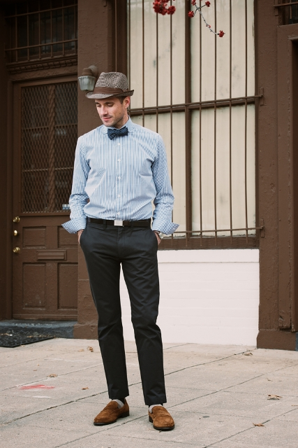 With pastel color printed shirt, bow tie, brown suede shoes and hat