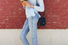 With pastel color shirt, jeans and mini bag