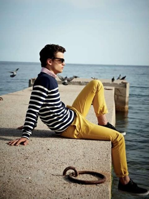 With pastel color shirt, striped sweatshirt and black sneakers