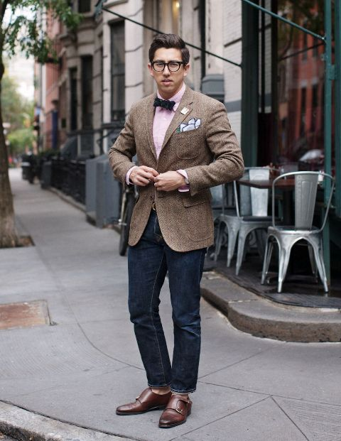 With pink shirt, bow tie, tweed jacket and jeans