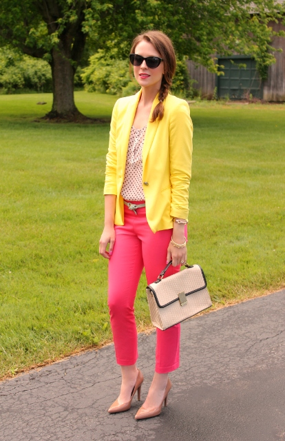 With polka dot shirt, hot pink pants, neutral color shoes and bag