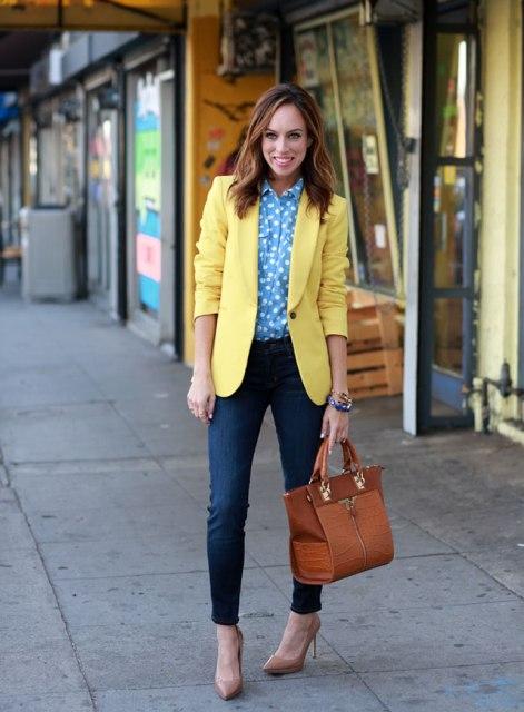 With polka dot shirt, jeans and brown bag