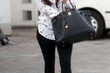 With polka dot shirt, skinny pants and black bag
