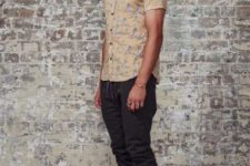 With printed button down shirt and gray and blue shoes