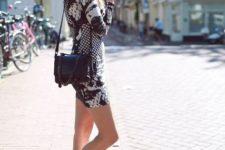 With printed mini dress and black bag