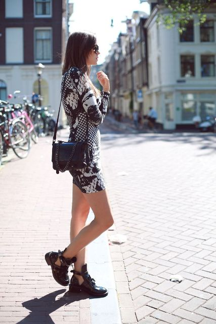 With printed mini dress and black bag