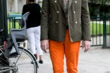 With printed shirt, olive green jacket and white shoes