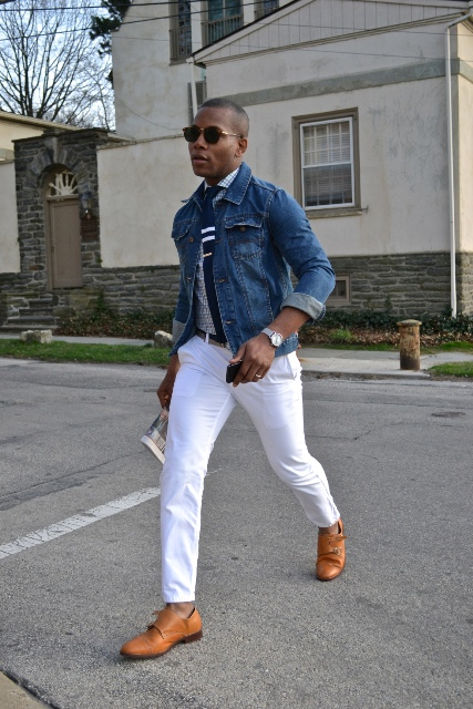 With printed shirt, white pants and denim jacket