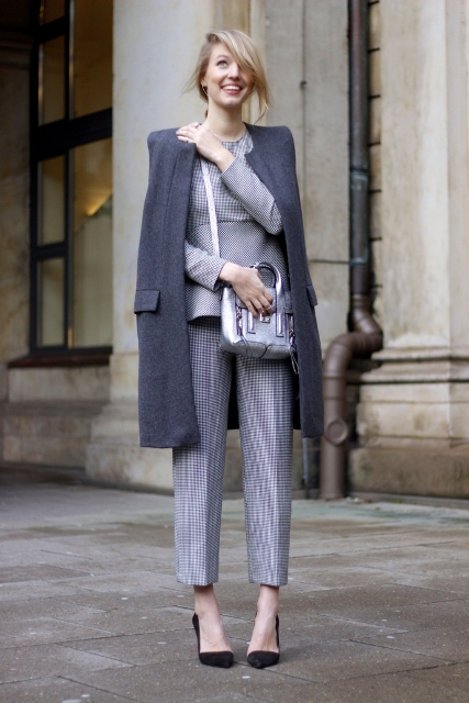 With printed suit, black pumps and coat