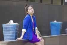 With purple mini dress and blue jacket