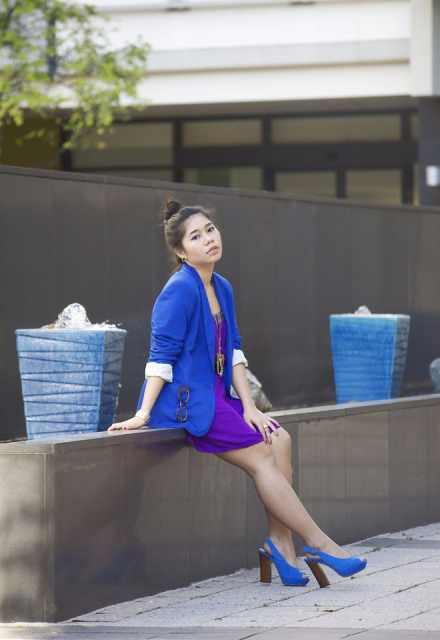 With purple mini dress and blue jacket