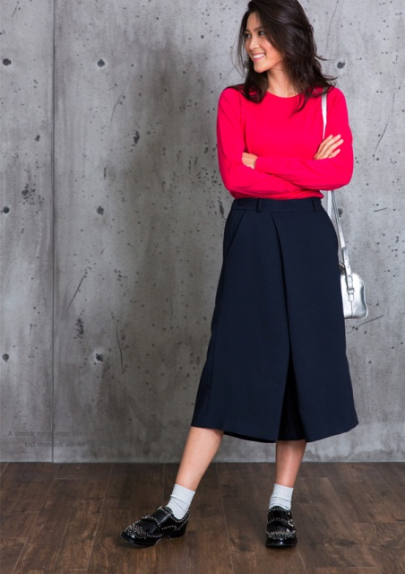 With red shirt, midi skirt and metallic crossbody bag