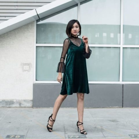 With sheer blouse and black heels
