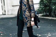 With shirt, black pants and printed mini coat