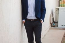 With shirt, navy blue jacket and brown shoes