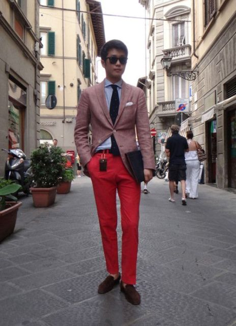 With shirt, tie and pale pink blazer