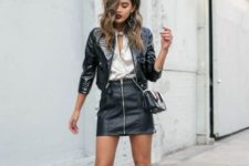 With silk blouse, leather jacket, mini skirt and chain strap bag