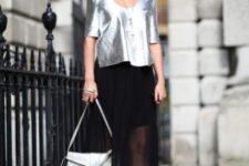 With silver metallic shirt, heels and sheer skirt