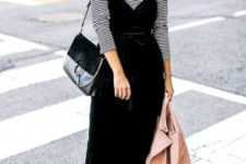 With striped shirt, black bag and printed boots