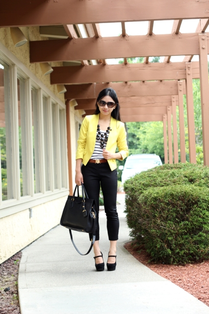 With striped shirt, crop jeans, platform shoes and big bag